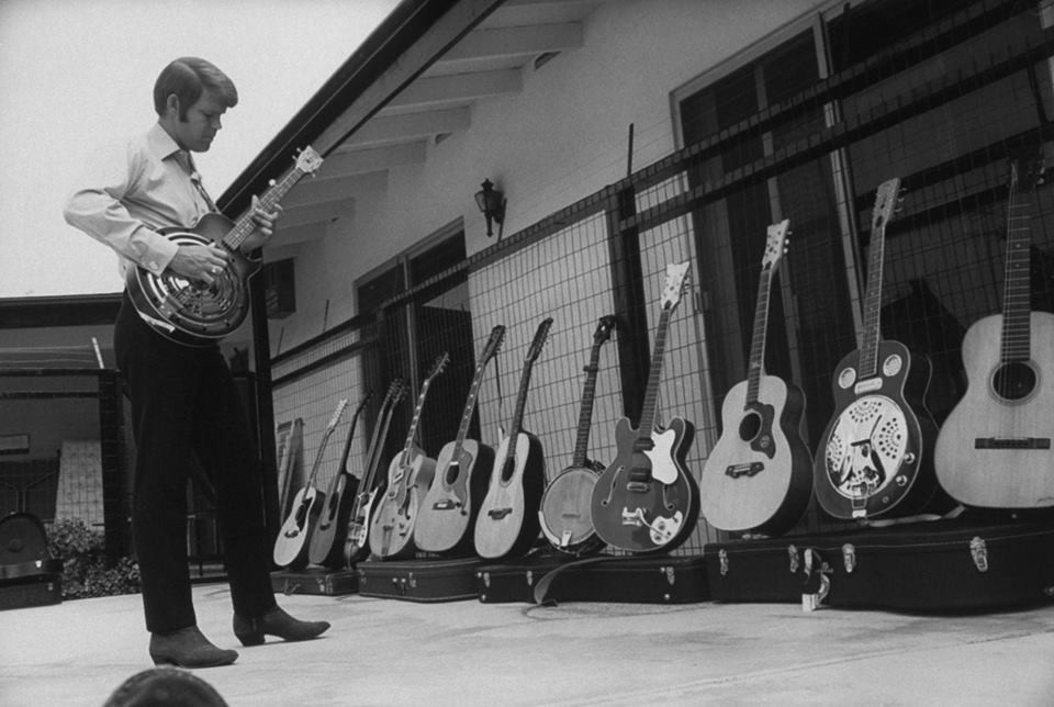 Glen Campbell Showcasing Guitars.jpg